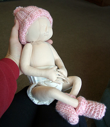 Doll with hat and booties